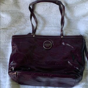 Gently used, purple patent leather Coach purse.